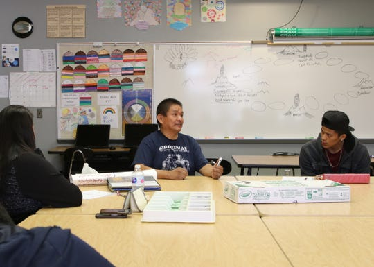 Joseph Chee, center, talks about Navajo philosophy during his Navajo culture and language class on Thursday at Career Prep High School in Shiprock.
