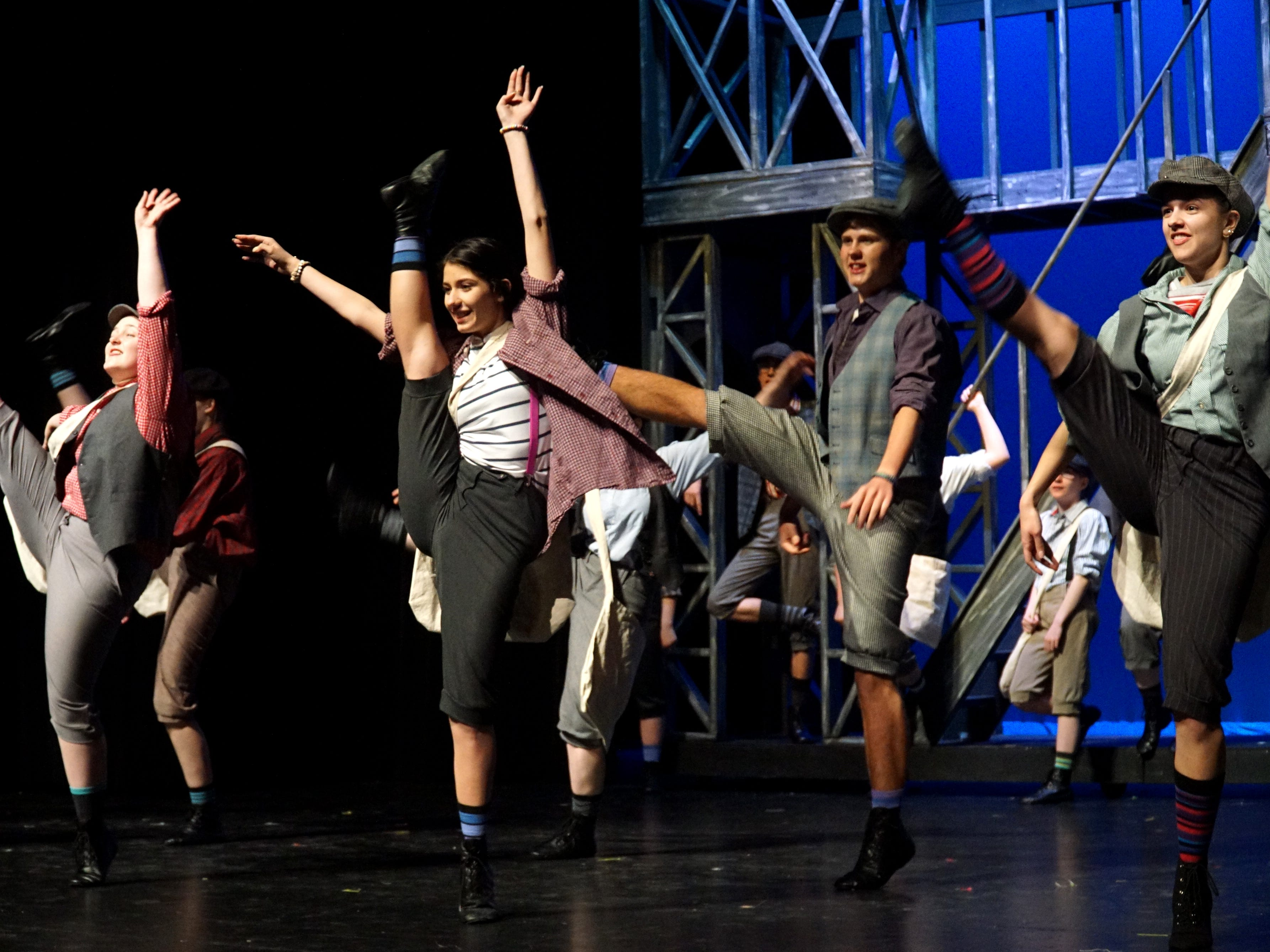 South Lyon East High's cast of Newsies rehearses a dance number from the Disney musical.
