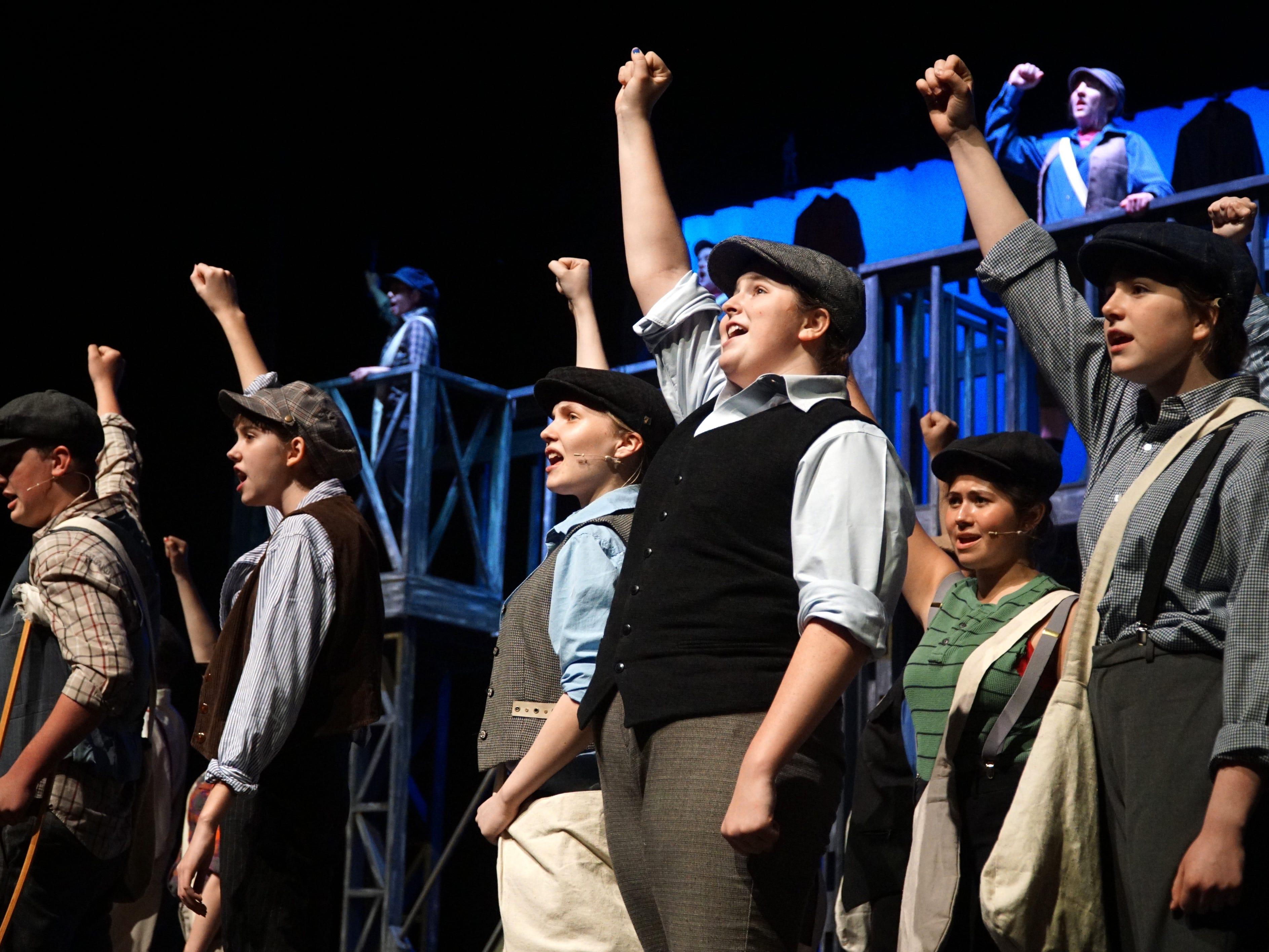 Cast of South Lyon East High's production of Newsies rehearses on April 18.