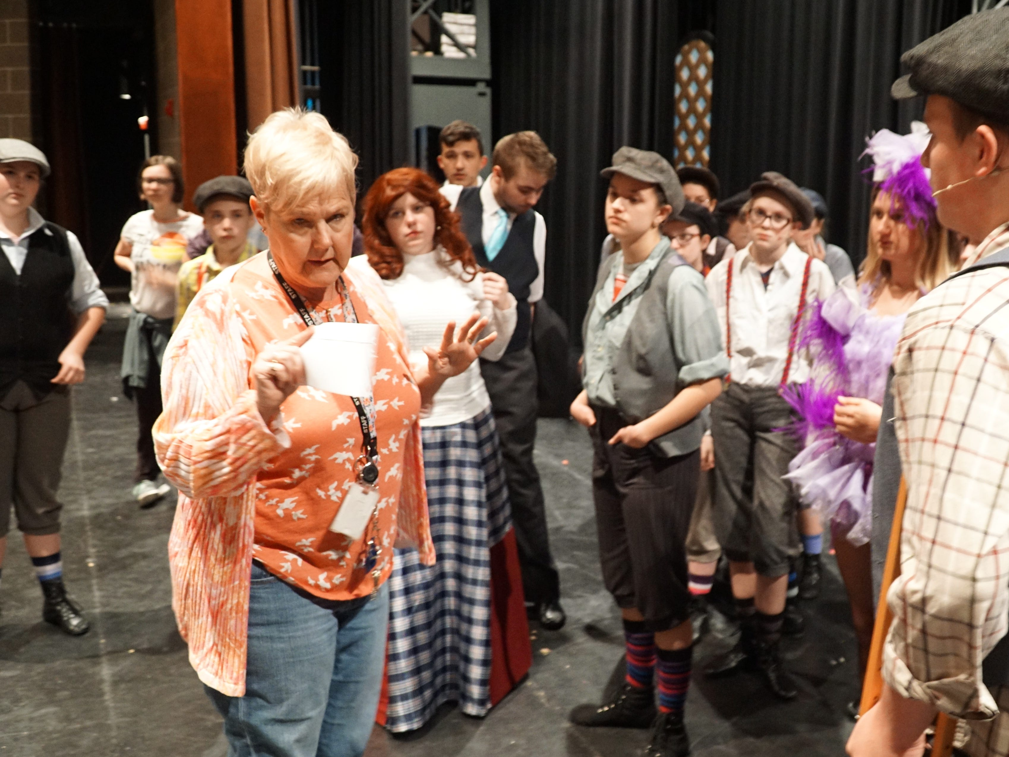 Newsies director Wendy Sielaff talks to her actors and crew before an April 18 rehearsal.