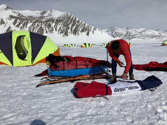 Ryan Waters, a guide for Antarctic Logistics & Expeditions, packs gear at Union Glacier Camp before leading Birmingham residents Richard Wallace and John Hamaty on a 60-mile trek to the South Pole.
