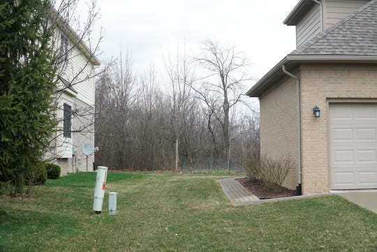 Residents of the Churchill Crossing development along Ten Mile Road might find that the Onyx Plaza business would come close to their backyards. The woods seen in the background are not too far from the proposed development.