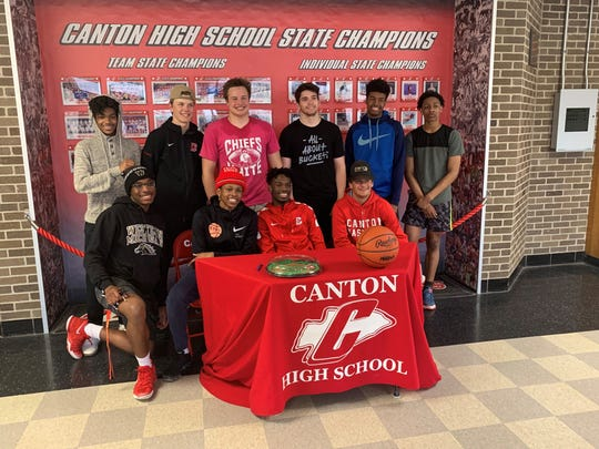 Canton's Vinson Sigmon is surrounded by teammates after signing his LOI to play basketball at Wisconsin Parkside.
