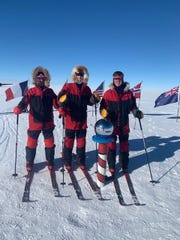 Dan Conner, Richard Wallace and John Hamaty reach the South Pole on New Year's Eve.