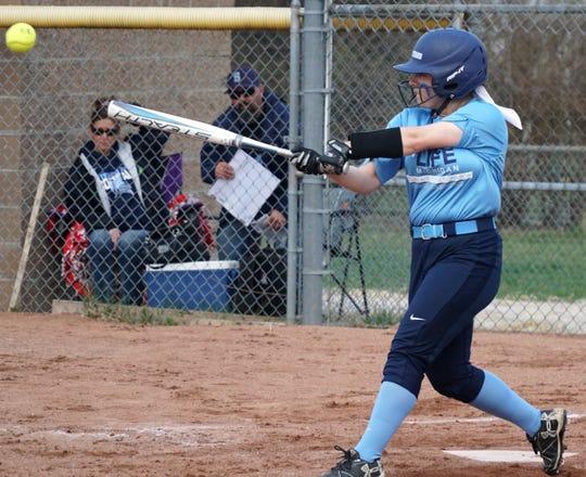 Grace Ozog hits a pitch.