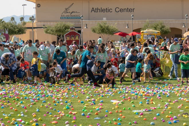 Children, students and parents enjoy an Easter Egg Hunt.