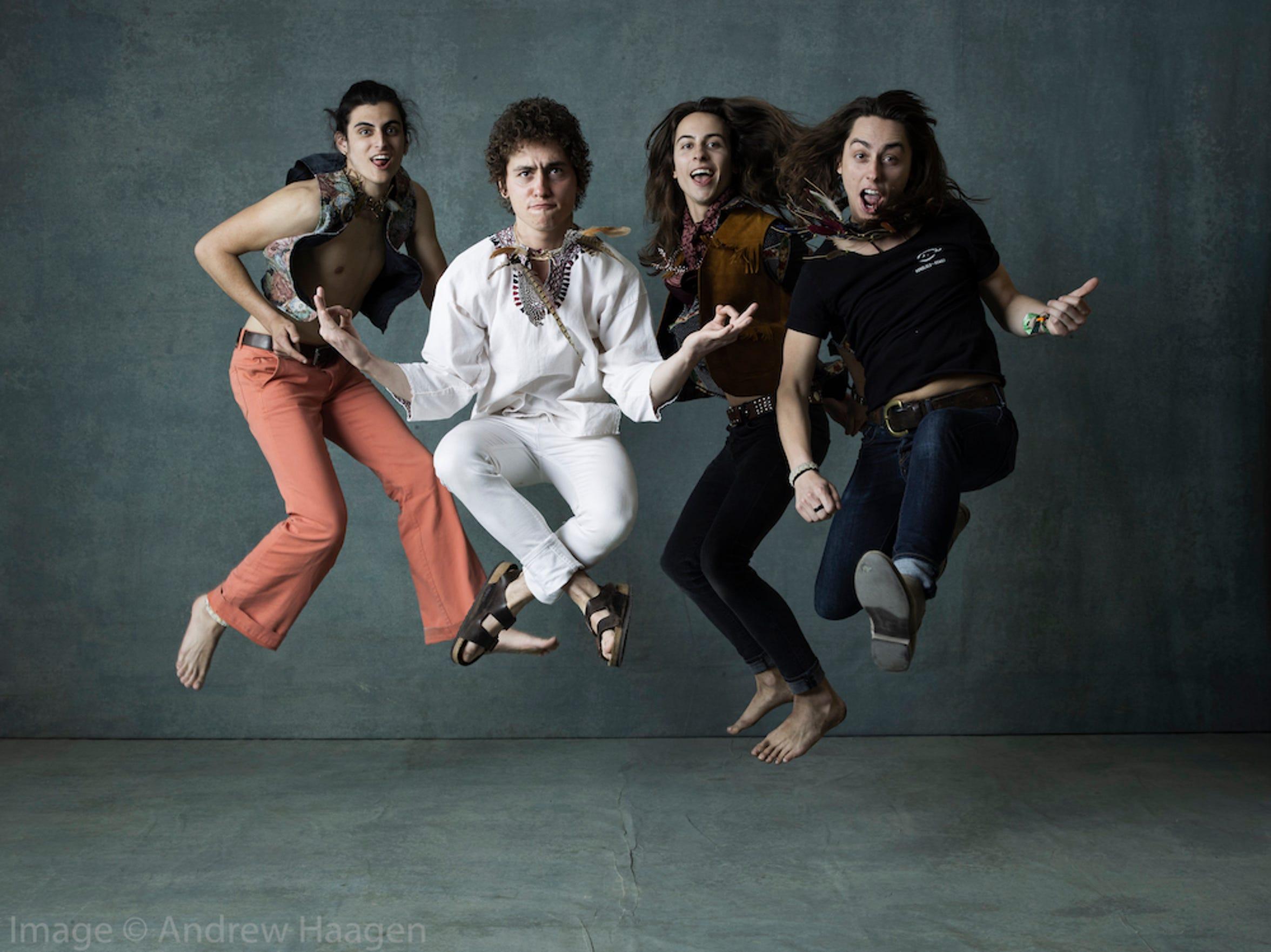 The rock band, Greta Van Fleet jumped for joy in Andrew Haagen's photo tent.