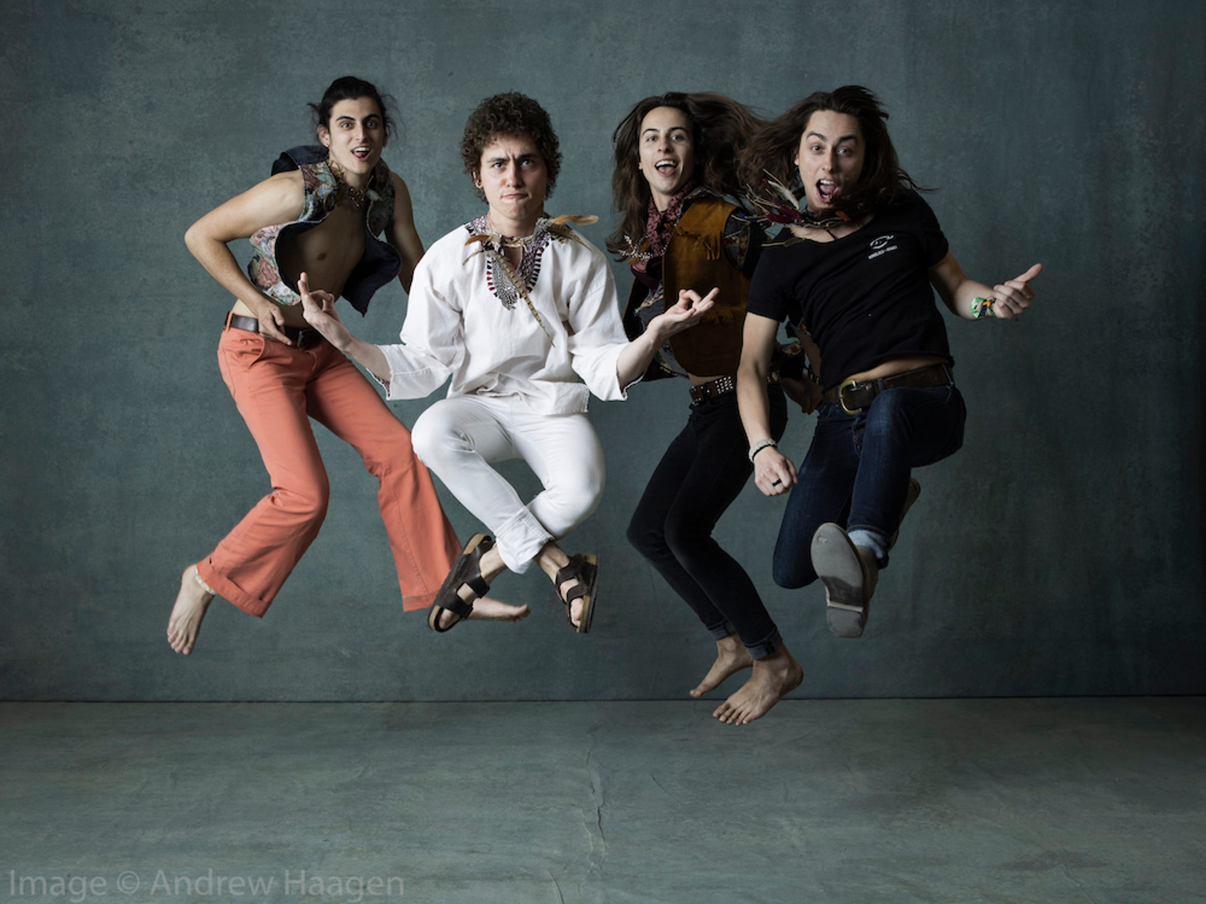 The rock band, Greta Van Fleet jumped for joy in Andrew Haagen's photo tent.
