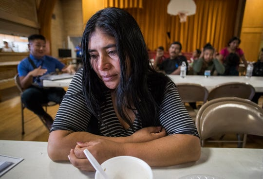 Heydy Cobon, a Guatemalan migrant, cries as she remembers the children she left behind in Guatemala. She is one of about 450 migrants that Riverside County employees have picked up at a Greyhound bus stop and transported to the Seventh-day Adventist Church in Blythe over the past three weeks.