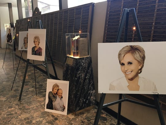 Photos of Barbara Keller adorn the lobby of Temple Isaiah in Palm Springs. A memorial service was held Thursday for the philanthropist, who died Monday at the age of 75.