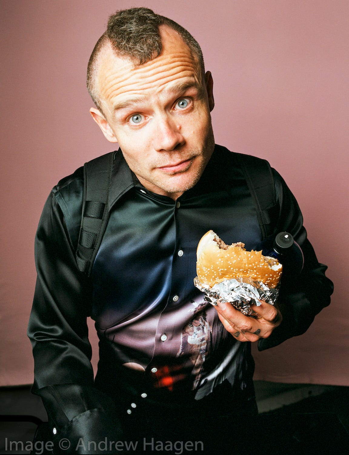 Flea, bassist for Red Hot Chili Peppers, had his portrait taken by Andrew Haagen in exchange for a burger