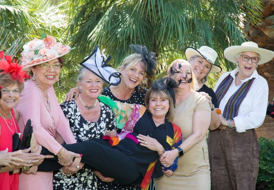 Pathfinder of the Year Deborah Garsh, center, is hoisted in the air by, from left, Judy Stone, Christina Kelly, Ellen Scheuer, Bib Scott, Kelly Downs, Melissa Perry and Marlene Lee.
