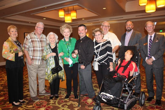 From left: United Cerebral Palsy of the Inland Empire Trustee Becci Lamele, President and CEO Greg Wetmore; Vice President Micki James; Coachella Valley Wellness Foundation President Patty Newman; Chairman Demitrious Sinor; Pat and Joe Manhart; John Sprogis; Cole Sprogis; and Rancho Mirage Councilman Ted Weill.