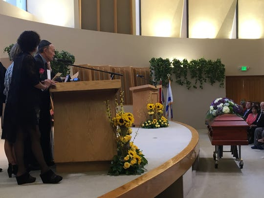 Jerry Keller speaks during a memorial service for his wife, Barbara, Thursday at Temple Isaiah in Palm Springs. The philanthropist died Monday at the age of 75.