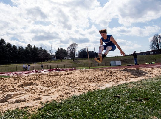 In this file photo, Spring Grove's Colson Martin competes in the long jump at South Western High School on Thursday, April 5, 2018. Martin has competed in two spring varsity sports since his freshman year.