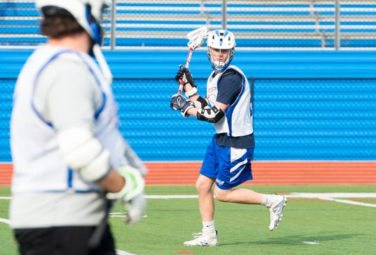 Spring Grove's Brock Martin runs through a drill during a lacrosse practice on Wednesday, April 17, 2019.