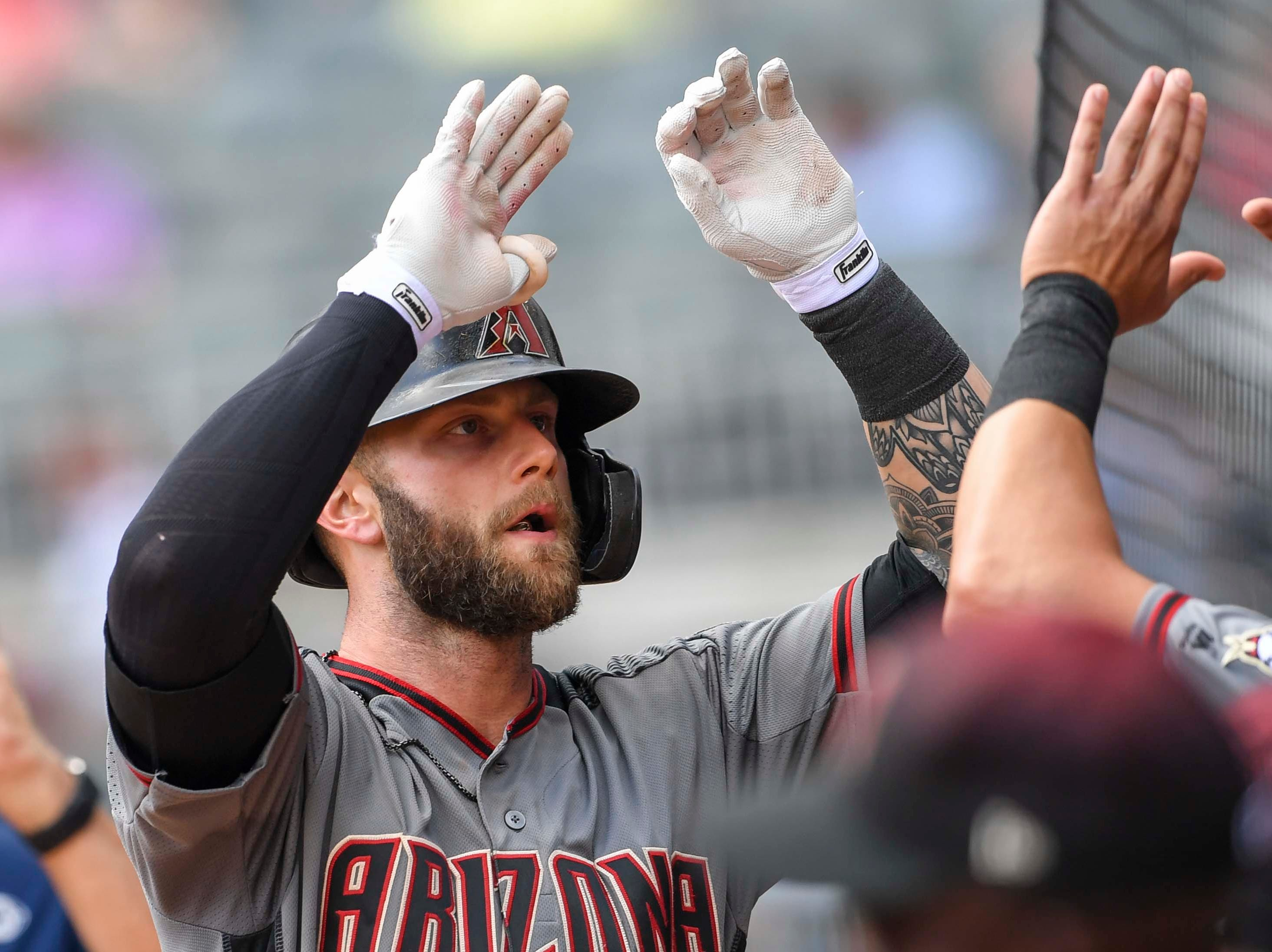 Apr 18, 2019; Atlanta, GA, USA; Arizona Diamondbacks first baseman Christian Walker (53) reacts with team mates after hitting a home run against the Atlanta Braves during the seventh inning at SunTrust Park. Mandatory Credit: Dale Zanine-USA TODAY Sports