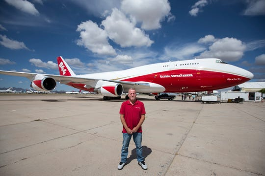 Scott Olson, Vice President of Maintenance for Global SuperTanker Services, poses for a portrait in front of the Global Supertanker, the world's largest wildfire-fighting aircraft, on April 17, 2019, at Pinal Air Park in Red Rock, Ariz. The plane is a retrofitted Boeing 747 and has been used to fight wildfires in California, Chile, and Israel, among other places.