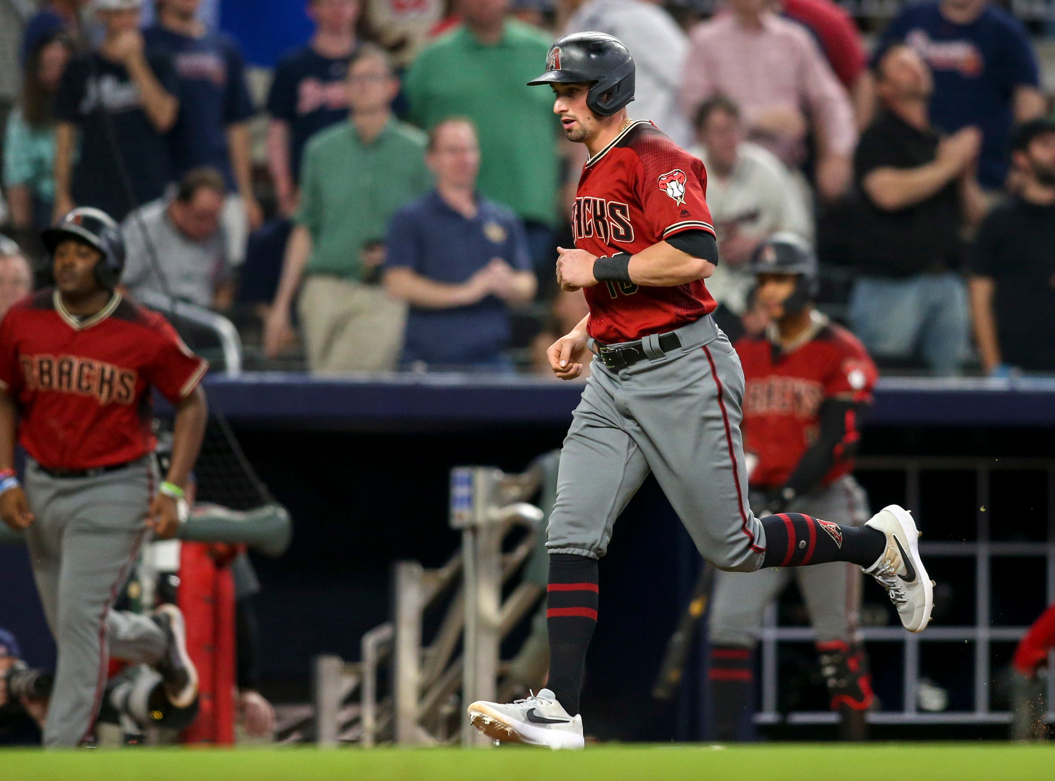 Apr 17, 2019; Atlanta, GA, USA; Arizona Diamondbacks center fielder Tim Locastro (16) scores on a walk against the Atlanta Braves in the tenth inning at SunTrust Park. Mandatory Credit: Brett Davis-USA TODAY Sports