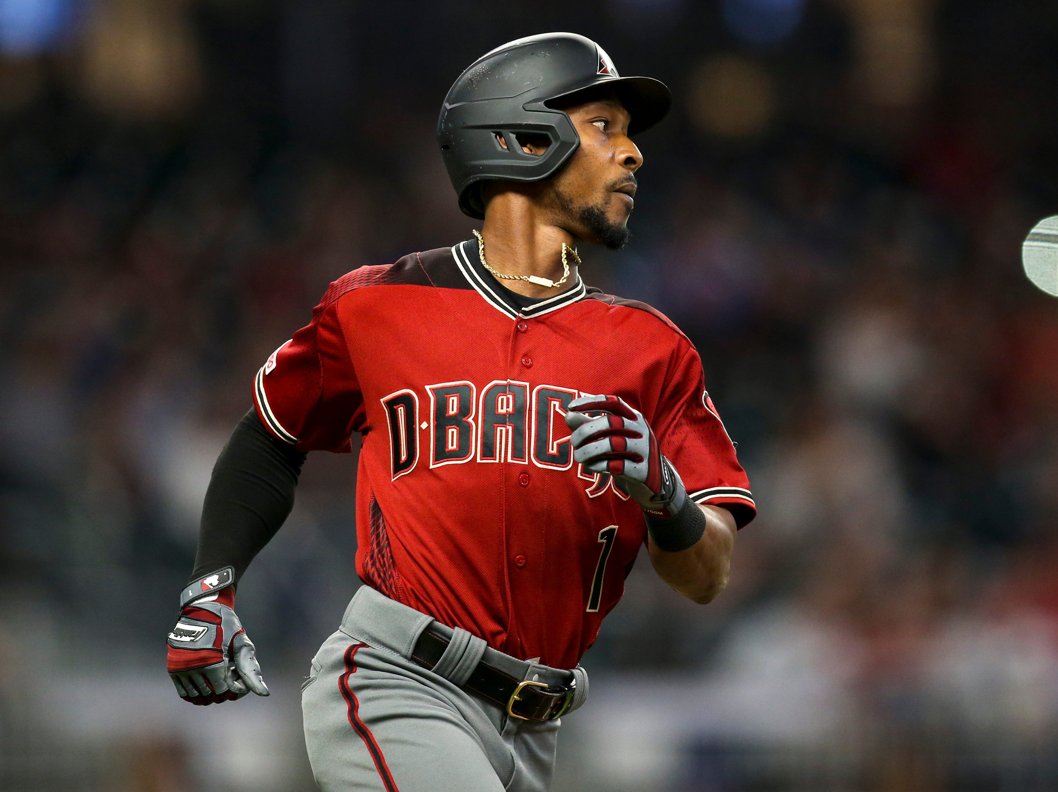 Apr 17, 2019; Atlanta, GA, USA; Arizona Diamondbacks center fielder Jarrod Dyson (1) hits a single against the Atlanta Braves in the eighth inning at SunTrust Park. Mandatory Credit: Brett Davis-USA TODAY Sports