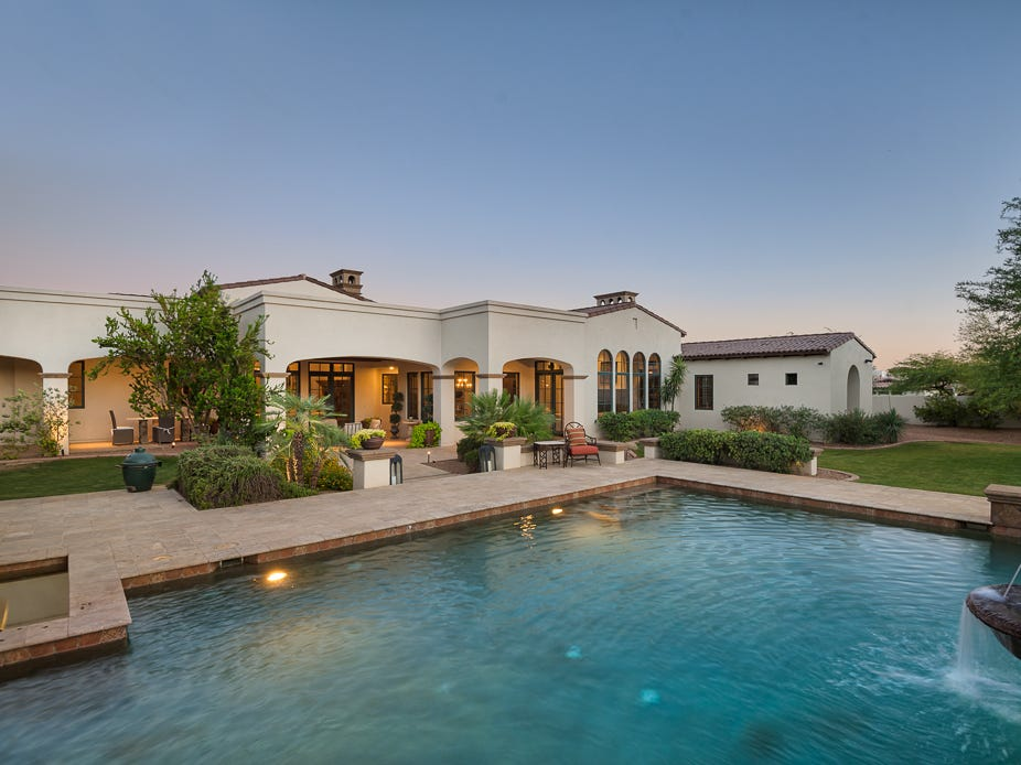 The 7,270-square-foot Paradise Valley mansion, purchased by Jonathan and Jennifer Scott, includes a pool, outdoor kitchen and ramada with a swim-up bar.