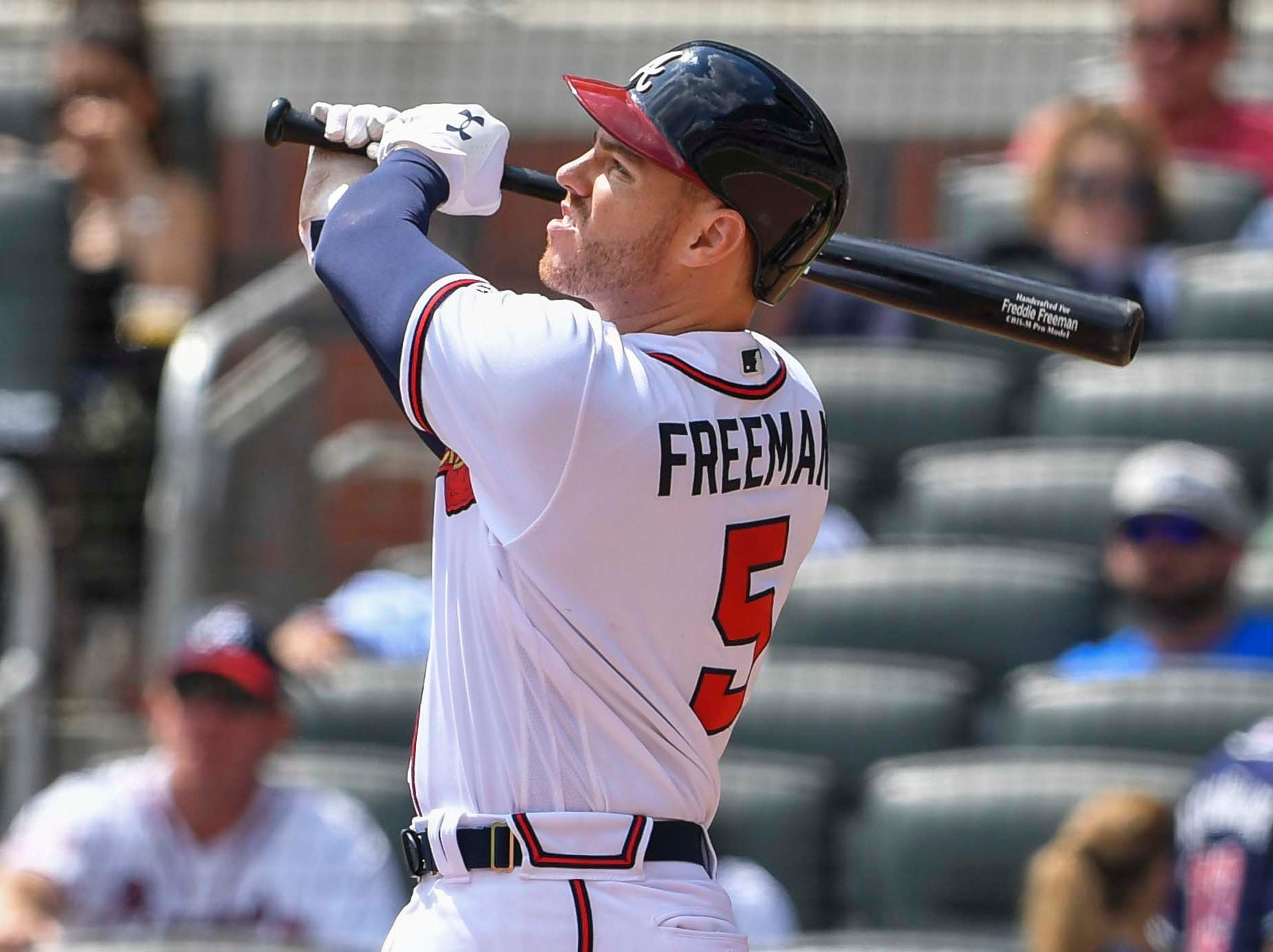 Braves first baseman Freddie Freeman hits a home run against the Diamondbacks during the eighth inning of a game at SunTrust Park.