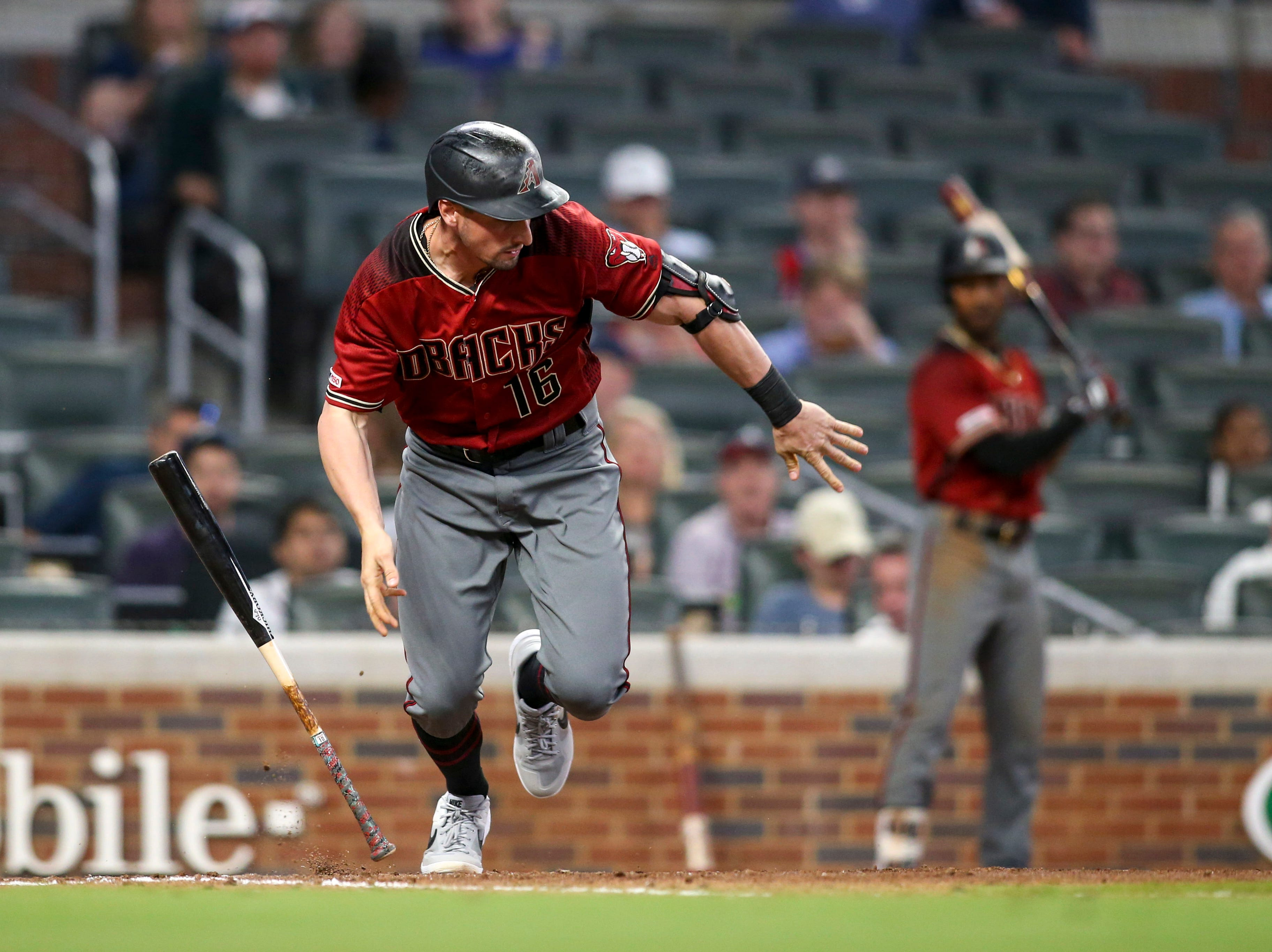 Apr 17, 2019; Atlanta, GA, USA; Arizona Diamondbacks center fielder Tim Locastro (16) reaches on an error against the Atlanta Braves in the tenth inning at SunTrust Park. Mandatory Credit: Brett Davis-USA TODAY Sports