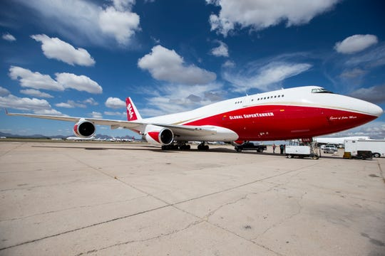 The Global SuperTanker, the world's largest wildfire-fighting aircraft, is seen on April 17, 2019, at Pinal Air Park in Red Rock, Ariz. The plane is a retrofitted Boeing 747 and has been used to fight wildfires in California, Chile, and Israel, among other places.
