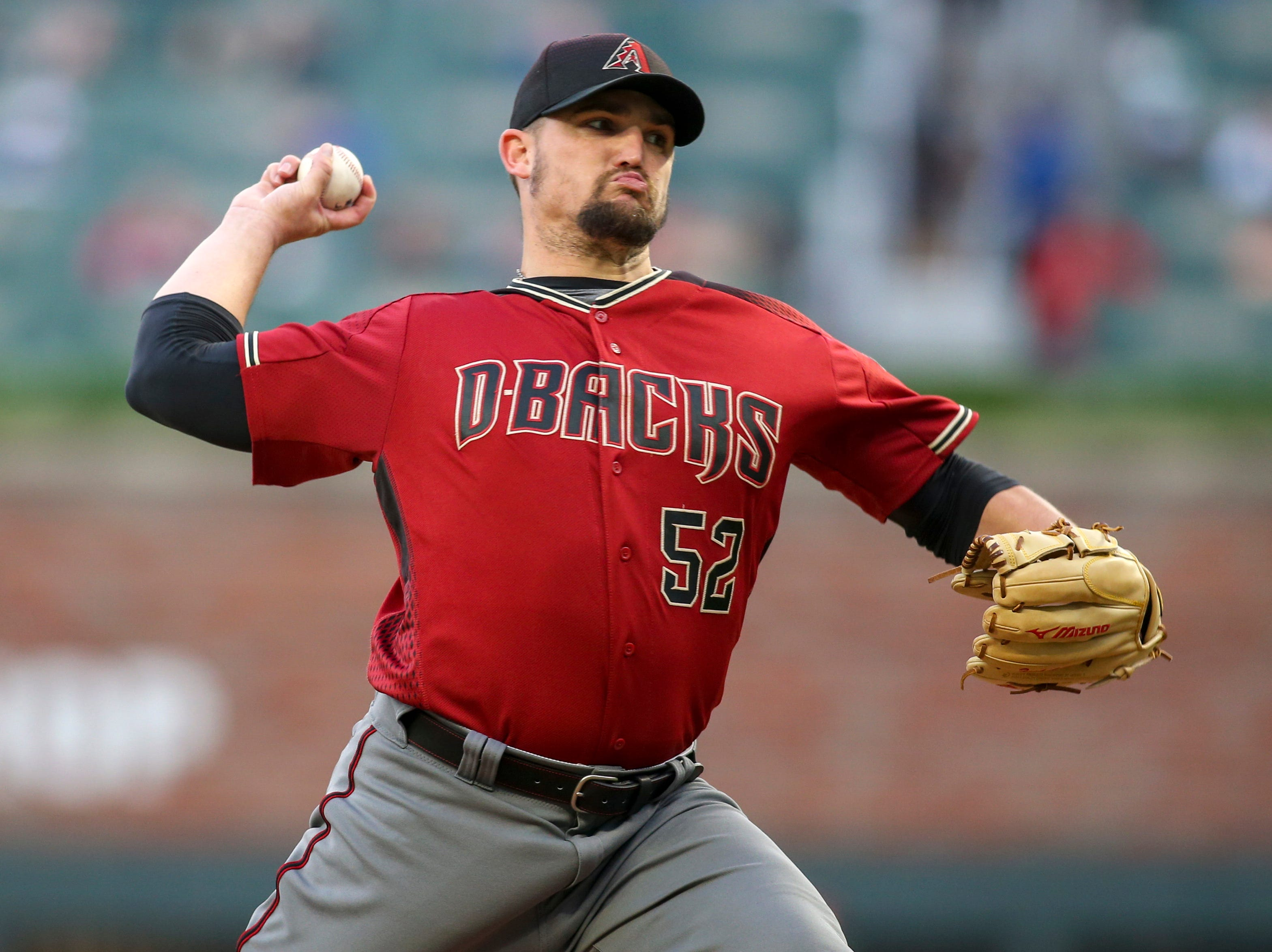Apr 17, 2019; Atlanta, GA, USA; Arizona Diamondbacks starting pitcher Zack Godley (52) throws against the Atlanta Braves in the first inning at SunTrust Park. Mandatory Credit: Brett Davis-USA TODAY Sports