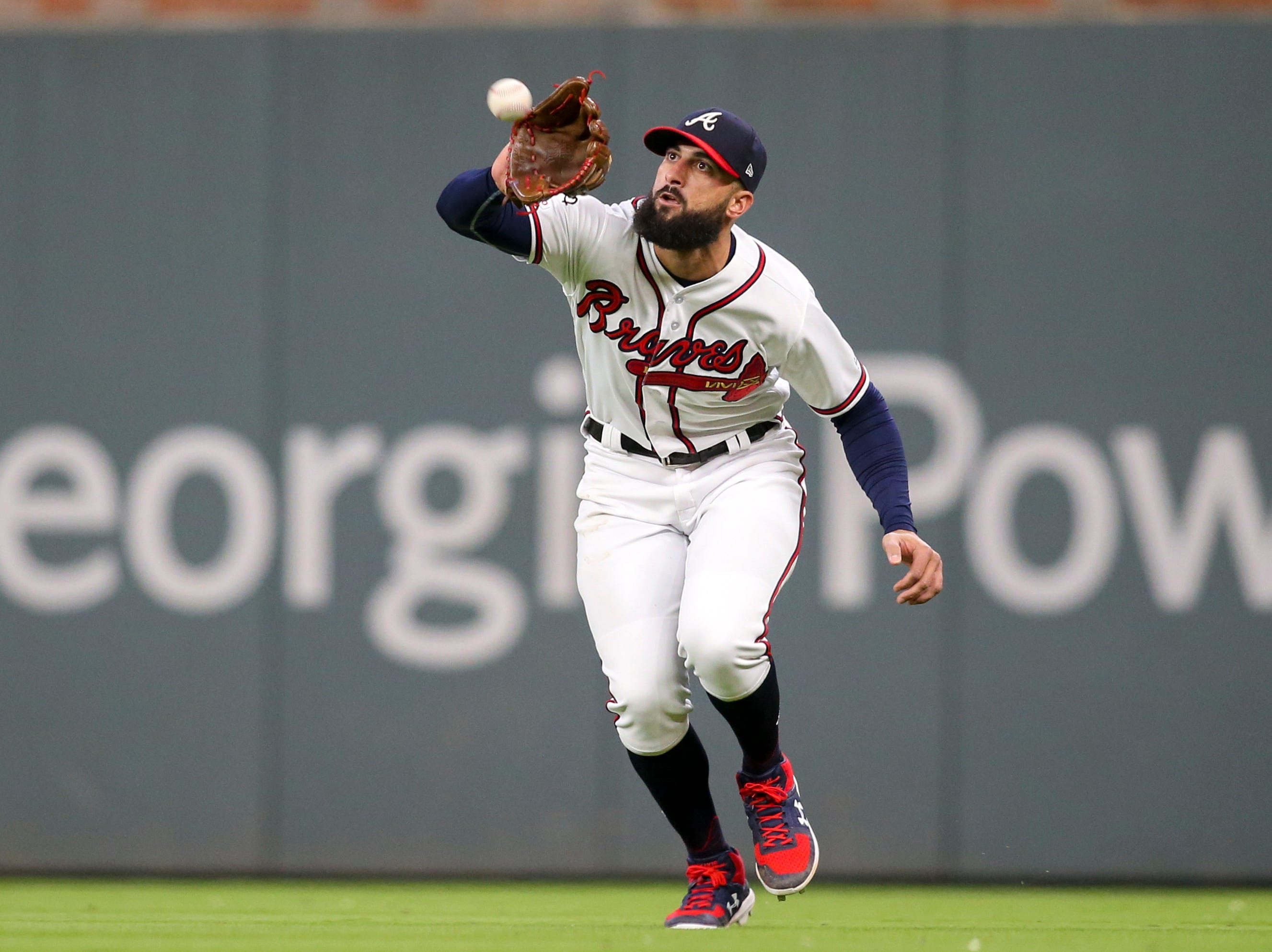 Apr 17, 2019; Atlanta, GA, USA; Atlanta Braves right fielder Nick Markakis (22) catches a fly ball against the Arizona Diamondbacks in the sixth inning at SunTrust Park. Mandatory Credit: Brett Davis-USA TODAY Sports