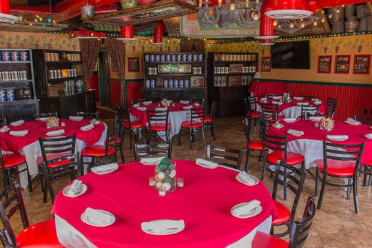 The party room at the Scottsdale and Shea location of Oregano's can fit up to 64 guests seated at round tables.