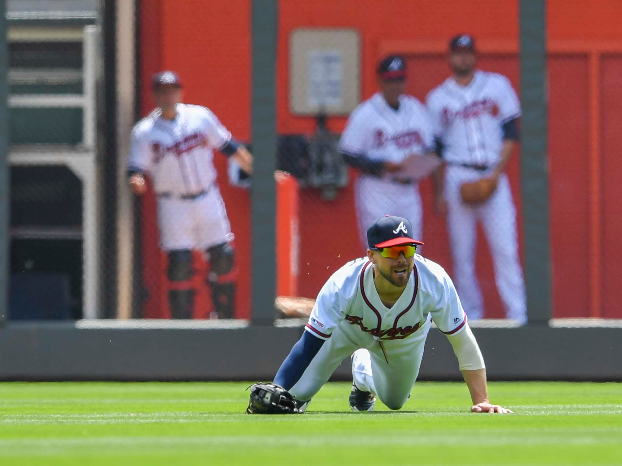 Apr 18, 2019; Atlanta, GA, USA; Atlanta Braves center fielder Ender Inciarte (11) makes a sliding catch on a ball hit by Arizona Diamondbacks third baseman Ildemaro Vargas (15) during the sixth inning at SunTrust Park. Mandatory Credit: Dale Zanine-USA TODAY Sports