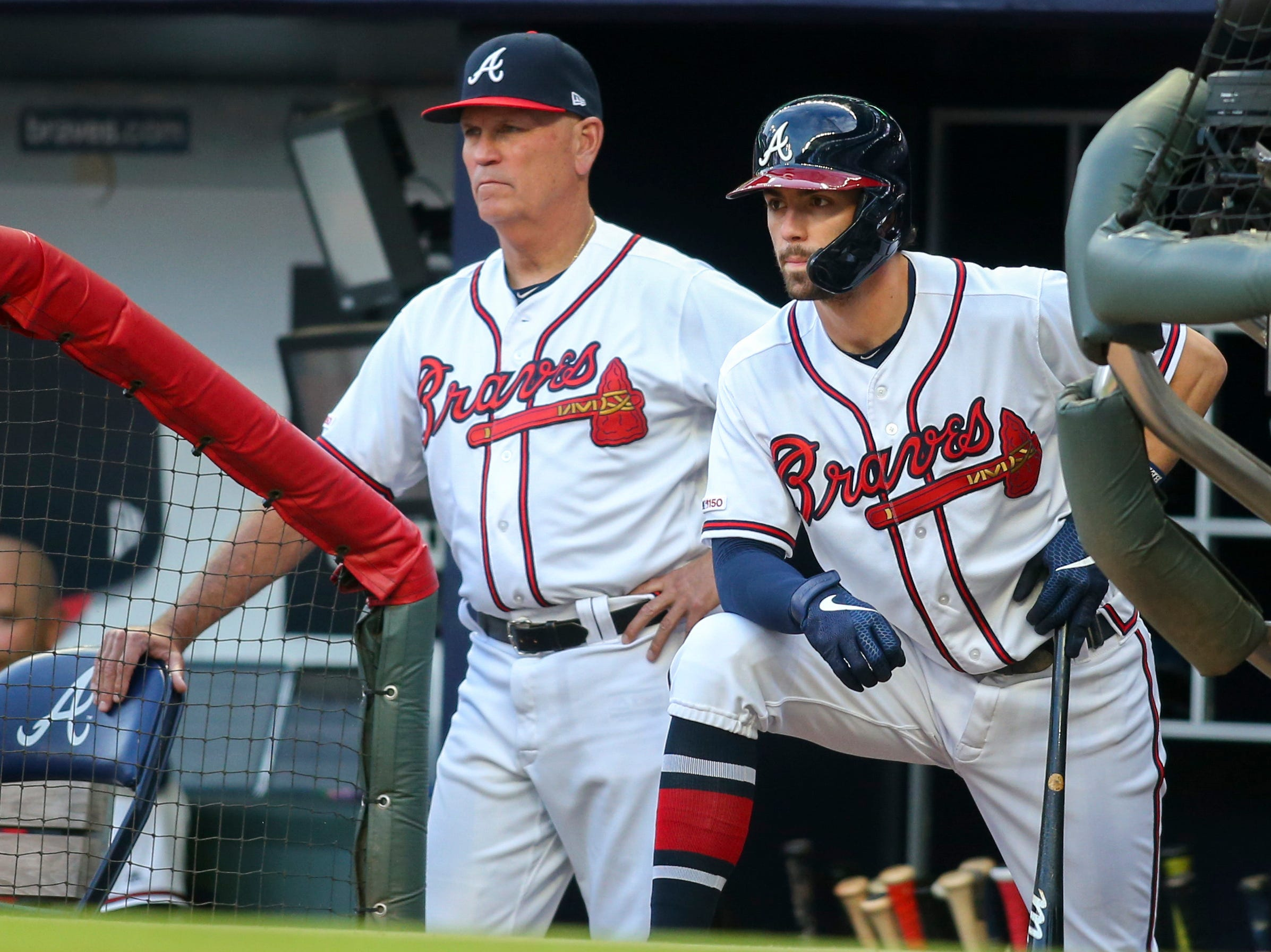 Apr 17, 2019; Atlanta, GA, USA; Atlanta Braves manager Brian Snitker (left) and shortstop Dansby Swanson (right) look on from the dugout against the Arizona Diamondbacks in the first inning at SunTrust Park. Mandatory Credit: Brett Davis-USA TODAY Sports