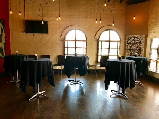 The Boardroom at Twisted Grover Parlor + Bar in Scottsdale includes a fireplace and private patio.