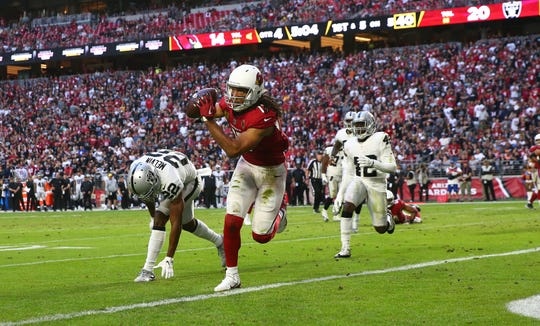 Arizona Cardinals wide receiver Larry Fitzgerald makes his second touchdown catch against the Oakland Raiders in the second half during a game Nov. 18 at State Farm Stadium.