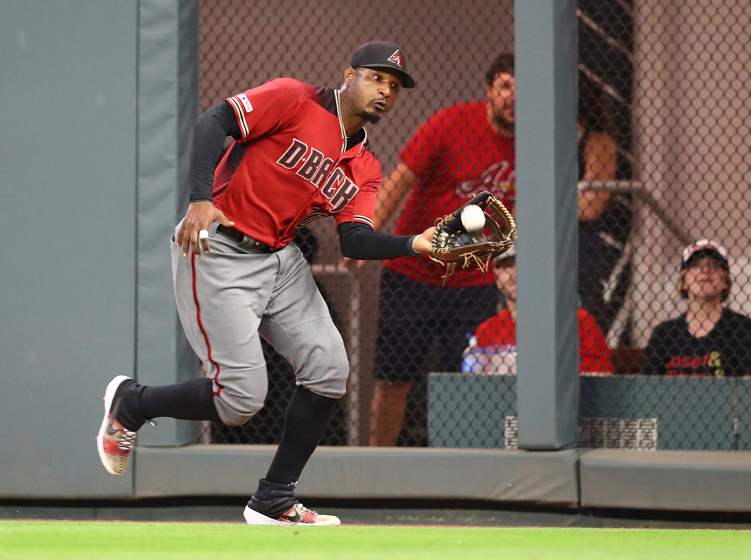 Arizona Diamondbacks right fielder Adam Jones runs down a long fly ball by Atlanta Braves' Dansby Swanson to end the eighth inning of a baseball game Wednesday, April 17, 2019, in Atlanta. (Curtis Compton/Atlanta Journal-Constitution via AP)