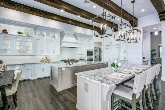 Ardy Rydell purchased this mansion in Scottsdale that features a chef's kitchen with double islands.
