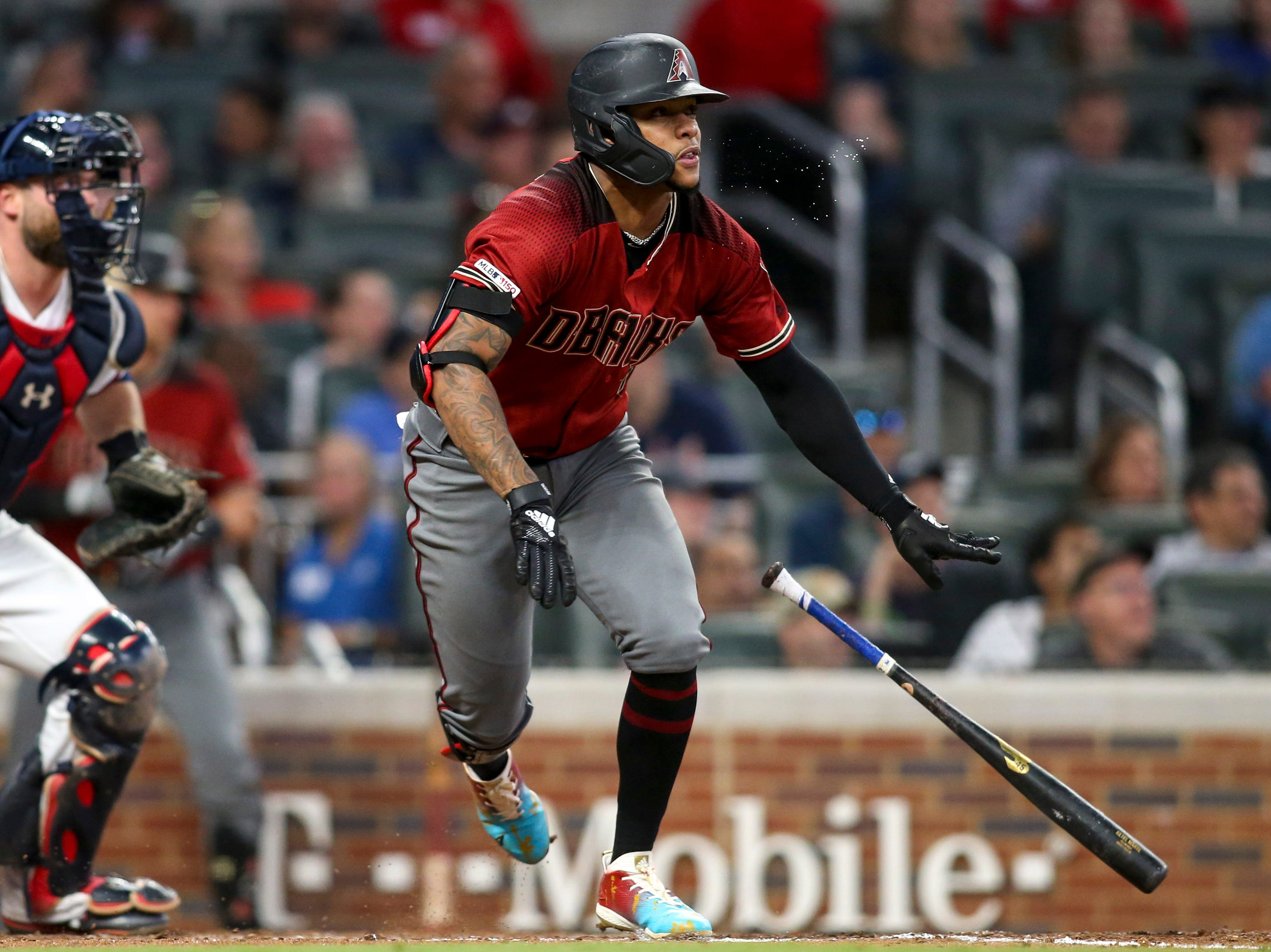 Apr 17, 2019; Atlanta, GA, USA; Arizona Diamondbacks second baseman Ketel Marte (4) hits a RBI double against the Atlanta Braves in the seventh inning at SunTrust Park. Mandatory Credit: Brett Davis-USA TODAY Sports