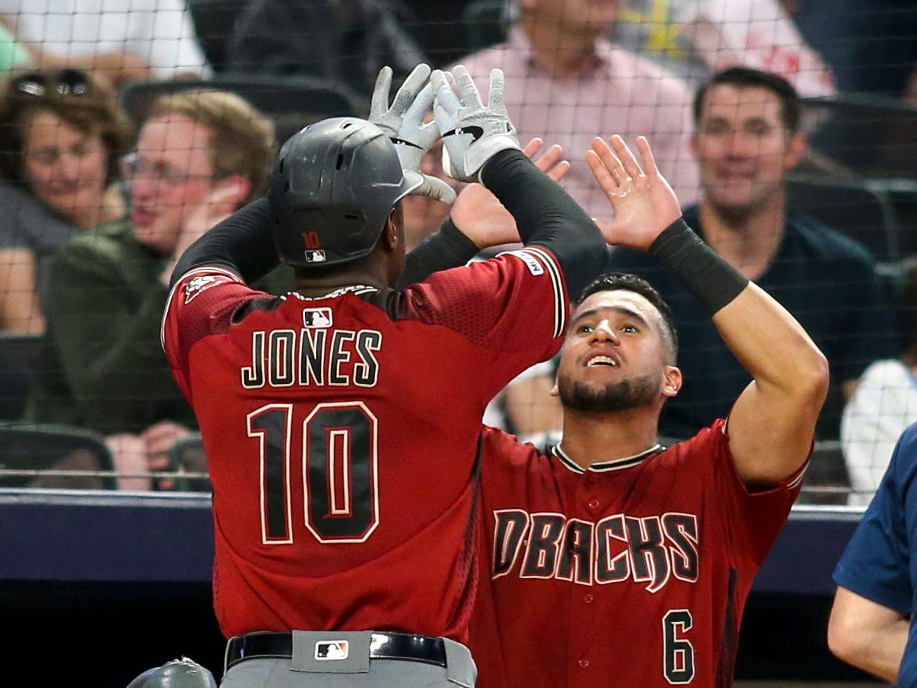 Apr 17, 2019; Atlanta, GA, USA; Arizona Diamondbacks right fielder Adam Jones (10) celebrates with left fielder David Peralta (6) after hitting a home run against the Atlanta Braves in the fourth inning at SunTrust Park. Mandatory Credit: Brett Davis-USA TODAY Sports