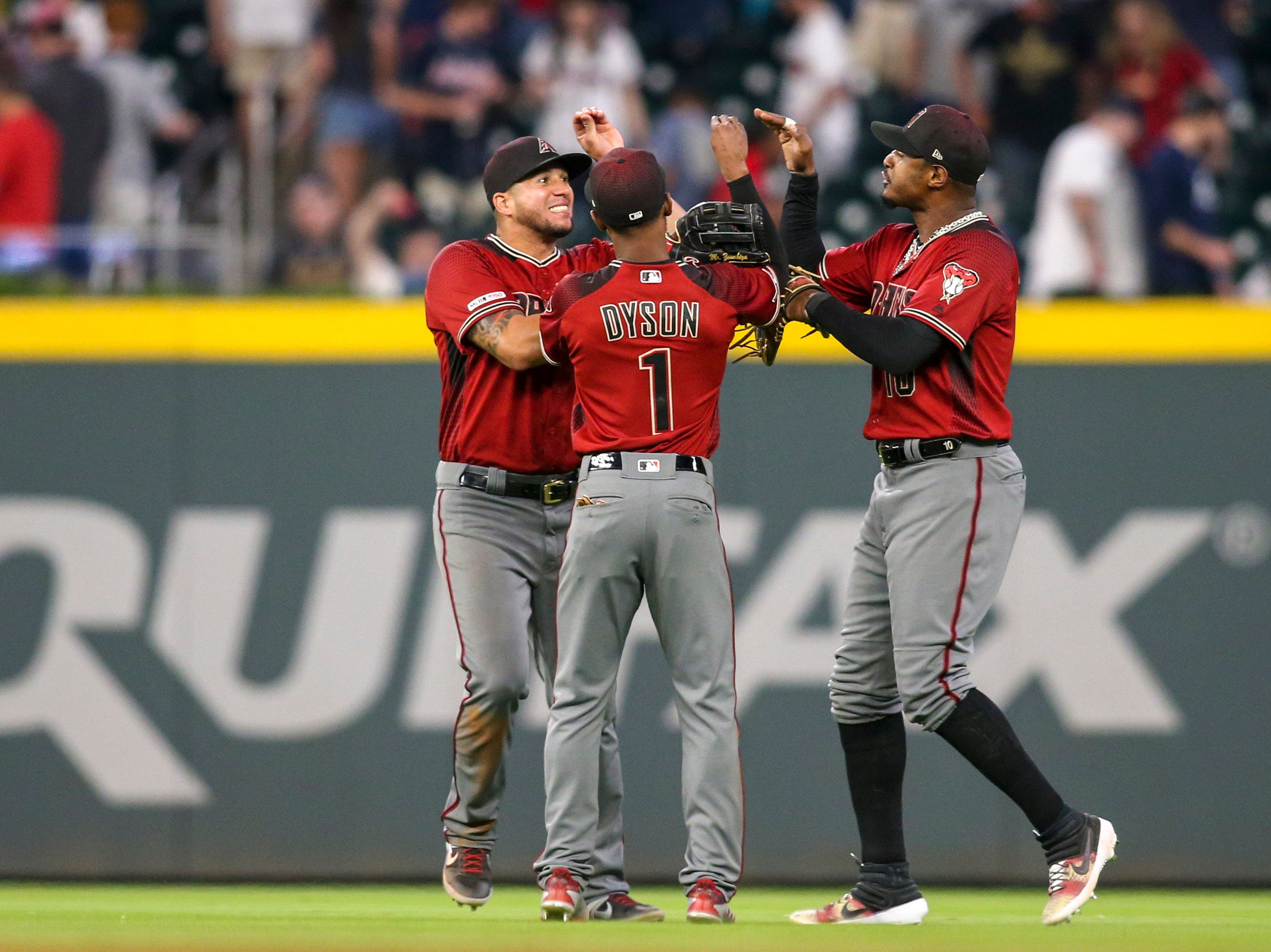 Apr 17, 2019; Atlanta, GA, USA; Arizona Diamondbacks left fielder David Peralta (6) and center fielder Jarrod Dyson (1) and right fielder Adam Jones (10) celebrate after defeating the Atlanta Braves at SunTrust Park. Mandatory Credit: Brett Davis-USA TODAY Sports