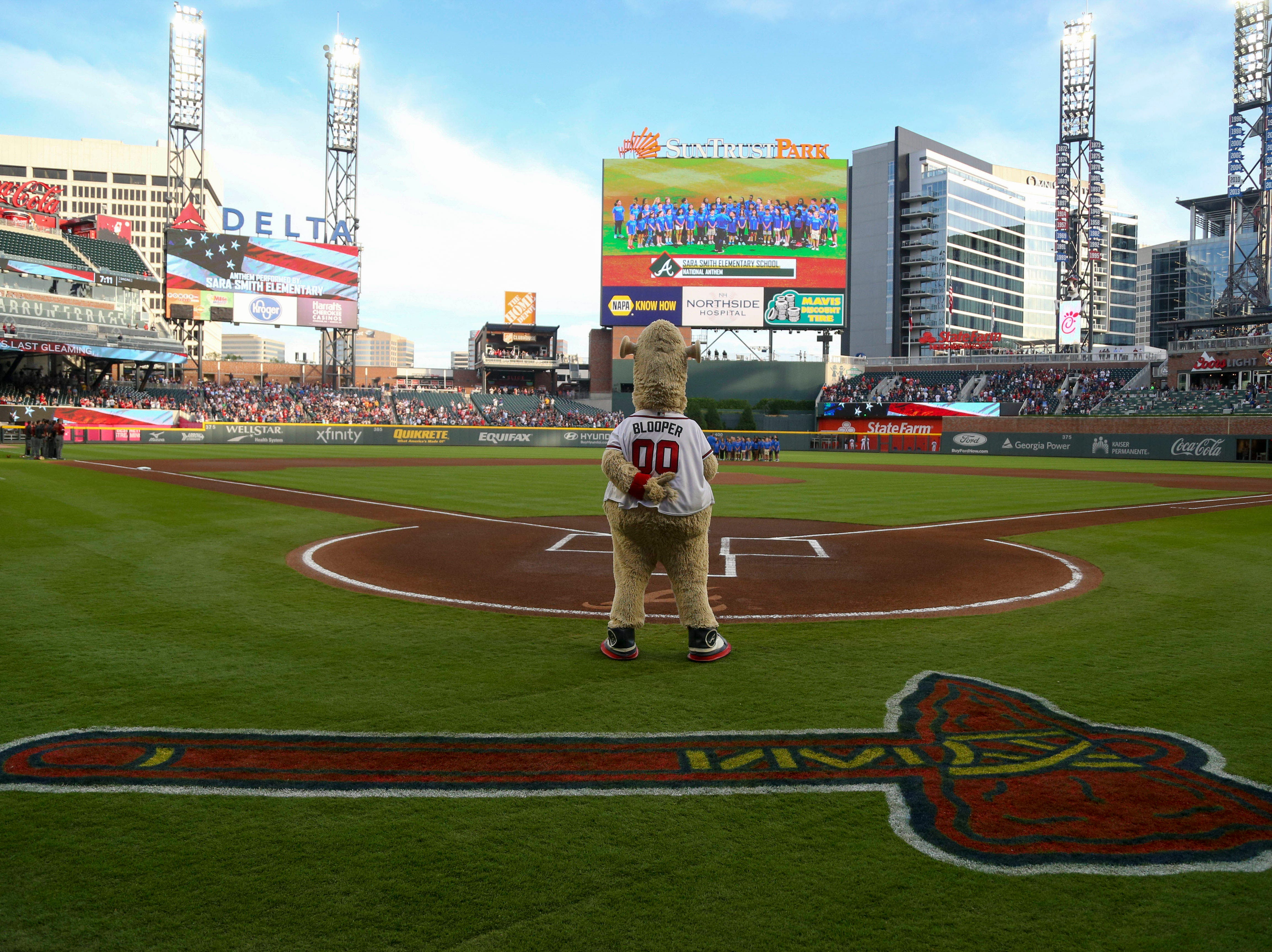 Apr 17, 2019; Atlanta, GA, USA; Atlanta Braves mascot Blooper stands during the national anthem before a game against the Arizona Diamondbacks at SunTrust Park. Mandatory Credit: Brett Davis-USA TODAY Sports