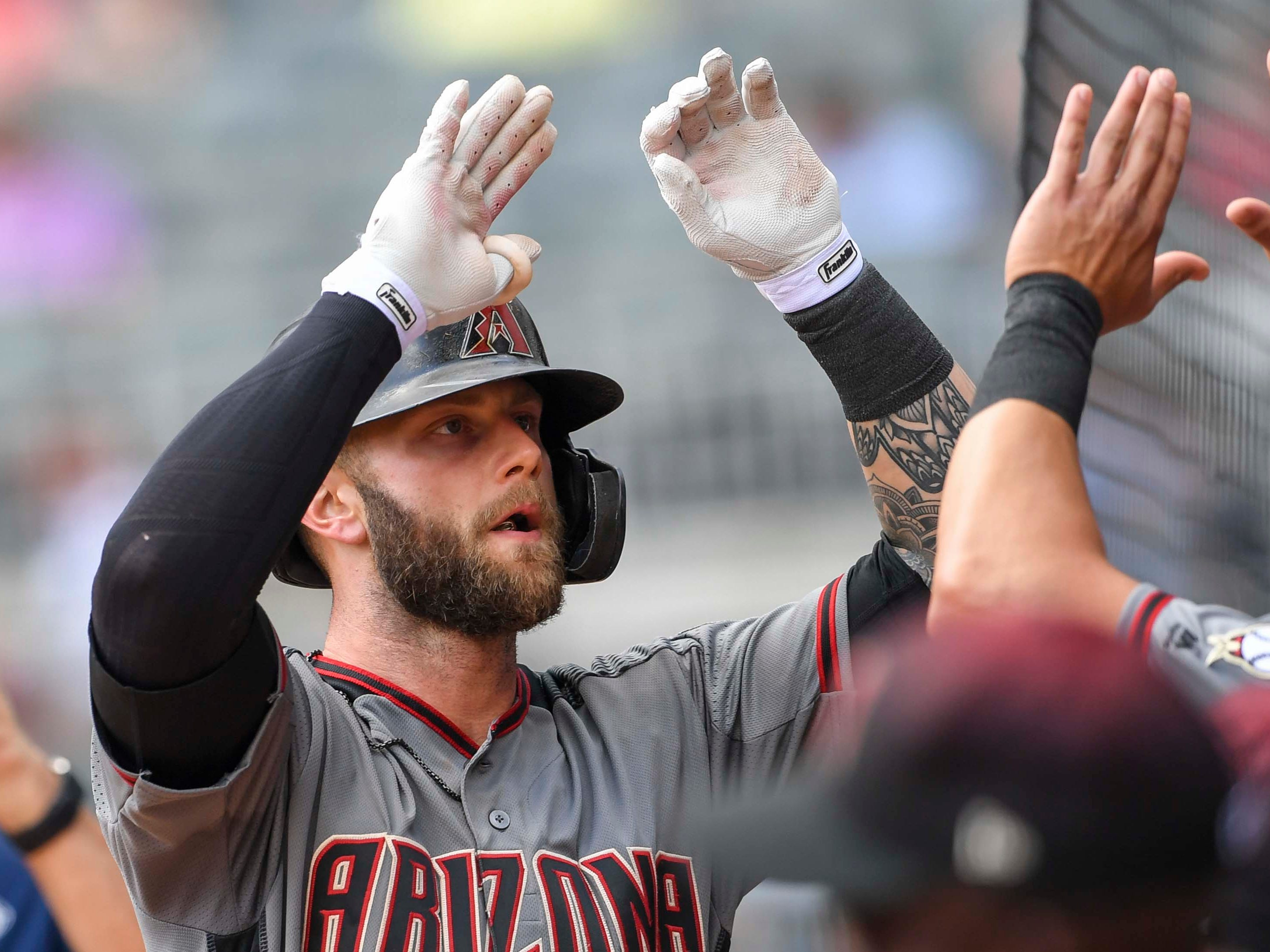 Diamondbacks first baseman Christian Walker celebrates with his teammates after hitting a two-run home run against the Braves on April 18.