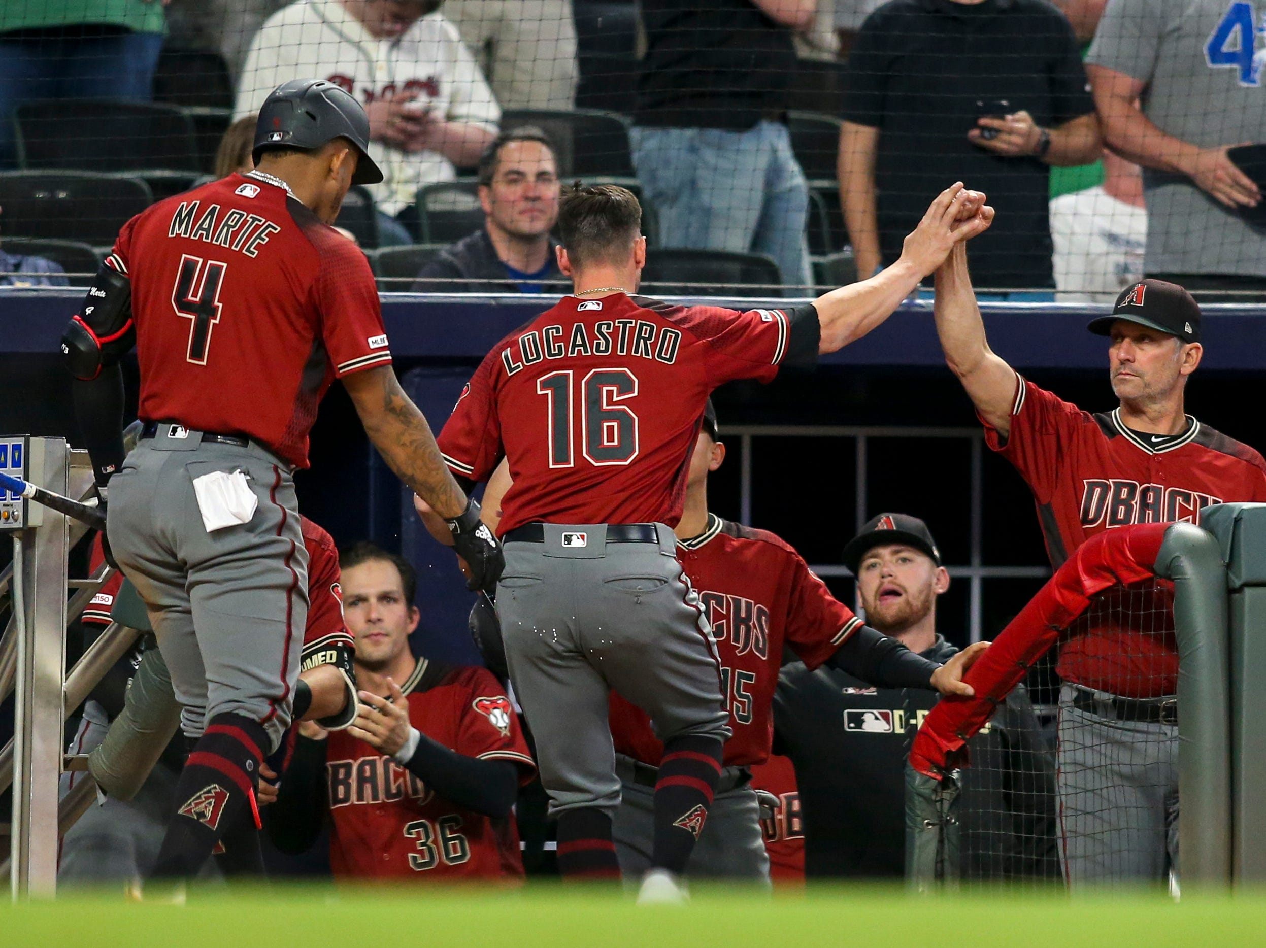 Apr 17, 2019; Atlanta, GA, USA; Arizona Diamondbacks center fielder Tim Locastro (16) celebrates with manager Torey Lovullo (17) after scoring against the Atlanta Braves in the tenth inning at SunTrust Park. Mandatory Credit: Brett Davis-USA TODAY Sports