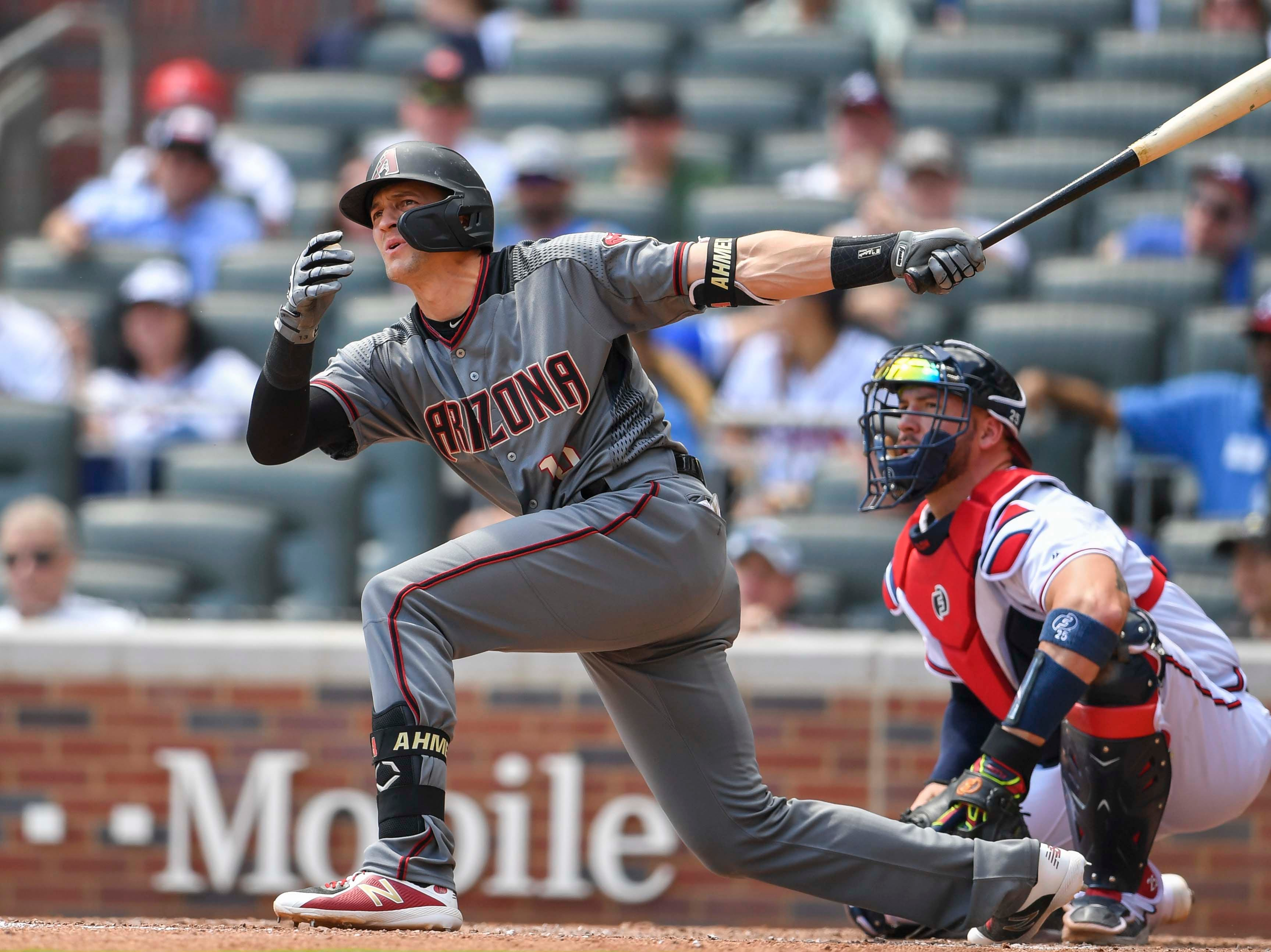 Apr 18, 2019; Atlanta, GA, USA; Arizona Diamondbacks pinch hitter Nick Ahmed (13) hits a double to drive in a run against the Atlanta Braves during the seventh inning at SunTrust Park. Mandatory Credit: Dale Zanine-USA TODAY Sports