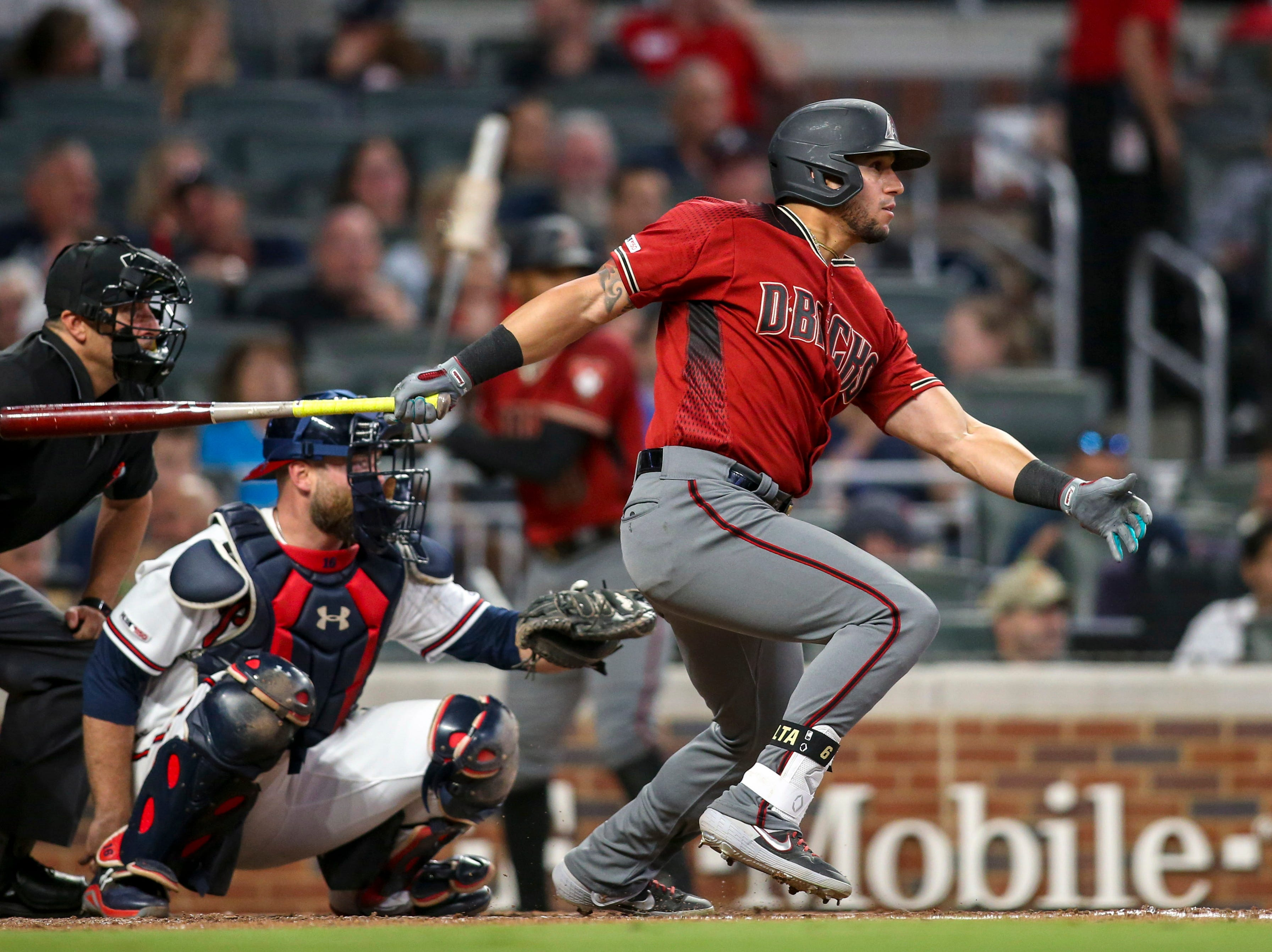 Apr 17, 2019; Atlanta, GA, USA; Arizona Diamondbacks left fielder David Peralta (6) hits a single against the Atlanta Braves in the seventh inning at SunTrust Park. Mandatory Credit: Brett Davis-USA TODAY Sports