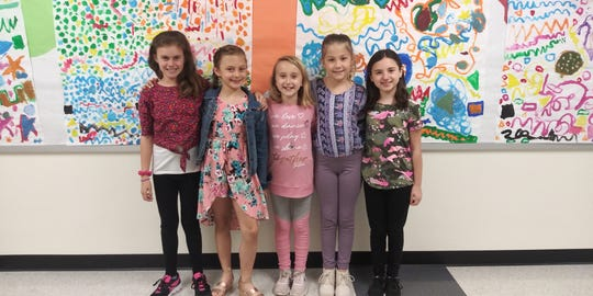 Addy Calnon, center, has the support of friends, from left, Laura, Leah, Izzy and Kali, as she lives with a serious heart condition, Long QT Syndrome.