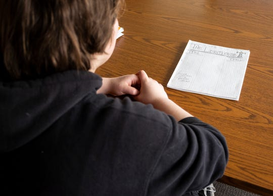 A mock-up of The Lighthouse newspaper drawn on graphing paper sits in front of James Barden, 15, during an interview Thursday, April 18, 2019. Barder, along with sophomore Emilia Lozano, recently restarted the newspaper.