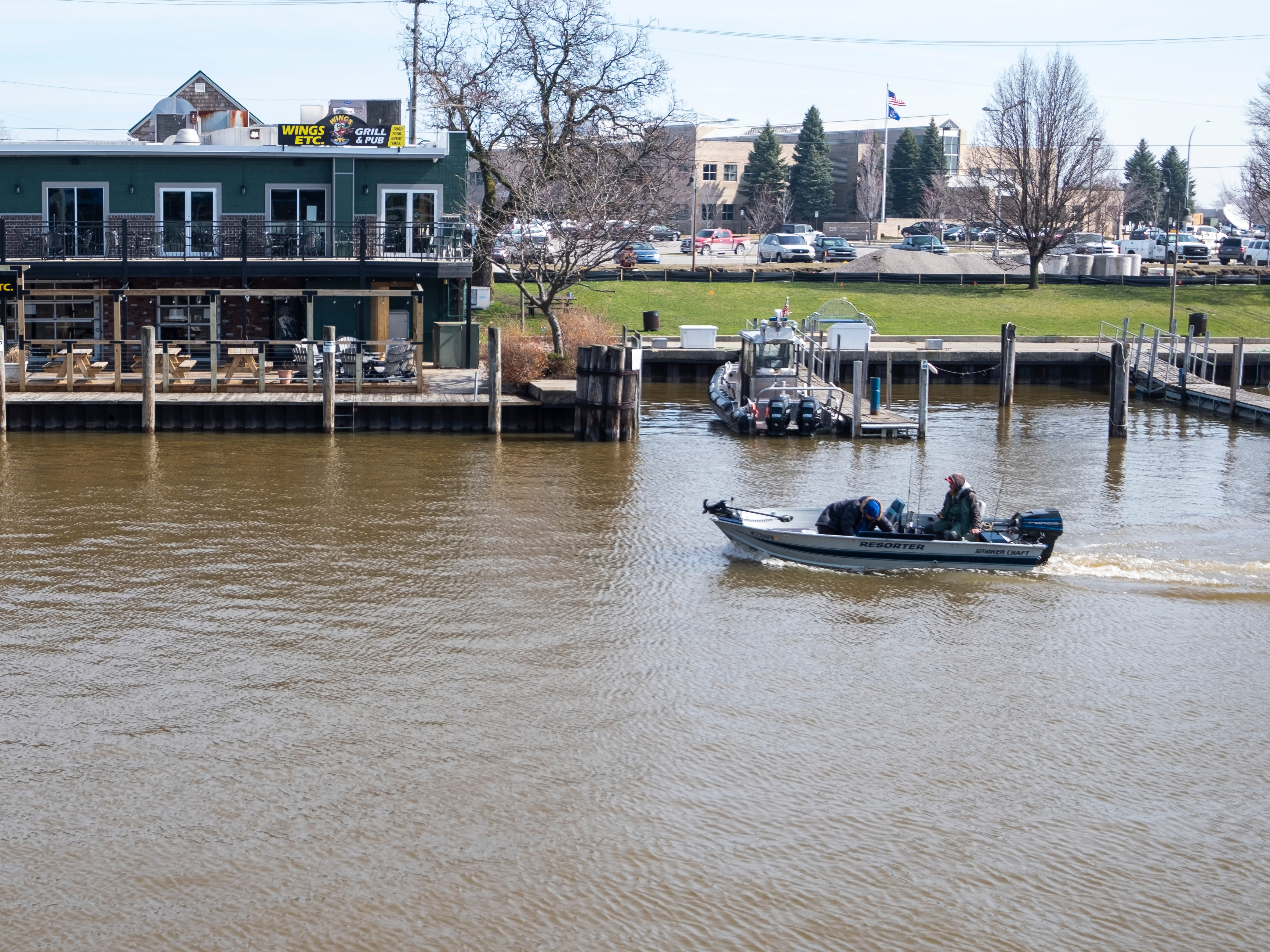 A fishing boat enters Port Huron on the Black River Wednesday, April 17, 2019.
