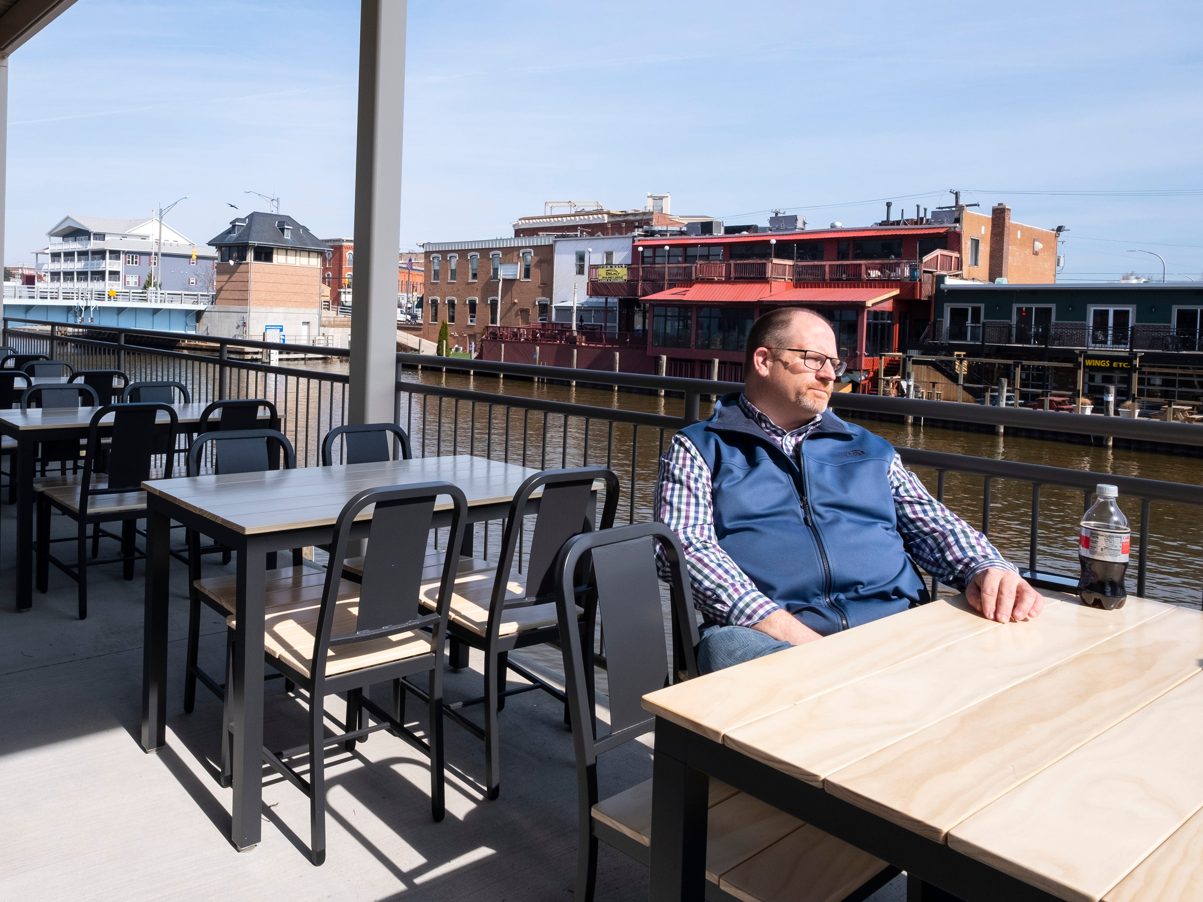 CityFlats Hotel project manager Scott Beedon sits on the patio outside TheKitchen  Wednesday, April 17, 2019.