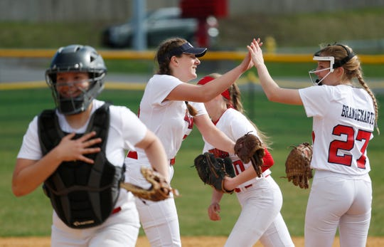 From left, Helena Van BenSchoten gives a high five to pitcher, Skylar Brandemarte high five prior to the start of Tuesday's game versus Fox Lane on April 16, 2019.